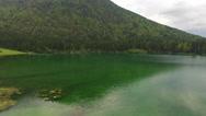 Aerial: Beautiful Green Mountain Lake At Summer Stock Footage