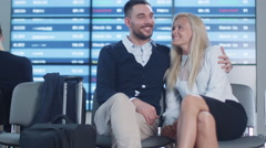 Man and Woman Talking while Waiting Boarding at Departure Lounge at the Airport. Stock Footage