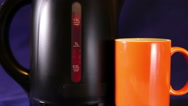Electric kettle and a mug, measured mark water level red color - a boiling sign Stock Footage