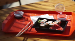 Sushi sets on a tray at an outdoor restaurant Stock Footage