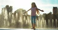 Girl child spinning on fountain background Stock Footage