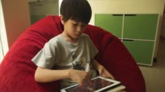 Little boy playing with Tablet (frontal) Stock Footage