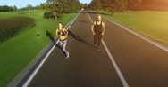Couple jogging in the park. 4k, 25 fps Stock Footage