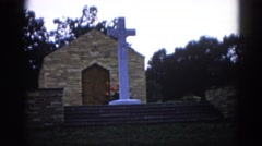 1962: a large white cross outside a small church CHICAGOLAND AREA Stock Footage