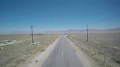Aerial Desert Road PedDown Stock Footage