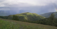 Swirling storm gives birth to a rainbow over Hells Canyon from Graves Point Arkistovideo