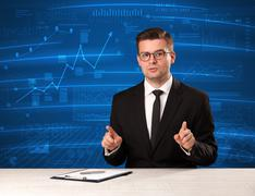 Stock data analyst in studio giving adivce on blue chart background Stock Photos