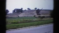 1962: a hill with a green field in the foreground CHICAGOLAND AREA Stock Footage