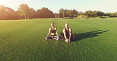 Yoga on green grass outdoor. 4k, 25fps Stock Footage