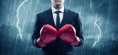 Businessman boxing in rain Stock Photos
