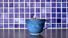 Tea cup and teabag on kitchen counter. Slow motion film clip. Stock Footage