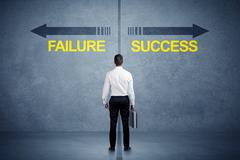 Businessman standing in front of success and failure arrow concept Kuvituskuvat