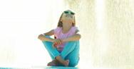 Girl sitting near fountain Stock Footage