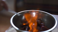 Professional cook preparing food on flame Stock Footage