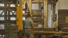 Foreman and worker doing his job at concrete blocks factory Stock Footage