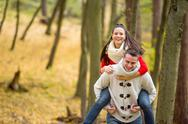 Couple in love, man giving his woman piggyback Stock Photos