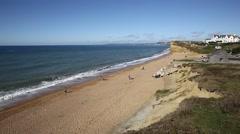 Burton Bradstock beach West Dorset England uk with people Stock Footage