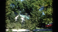 1962: the rooftop of a house rising about a grove of pine trees CHICAGOLAND AREA Stock Footage