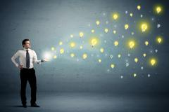 Businessman holding lightbulbs Stock Photos