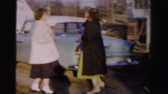 1956: women and child exit car in driveway and pose for a picture MADISON, Stock Footage
