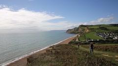 Walking the coast path towards Eype Dorset England uk Jurassic coast Stock Footage