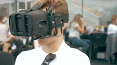 Man watching flight of FPV drone using VR glasses Stock Footage