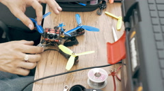 Man assembling FPV drone using tools Stock Footage