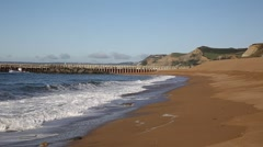 West Bay beach Dorset uk with waves and view to west Stock Footage
