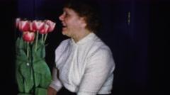 1956: a women making a weird face after having a smell of flower  Arkistovideo