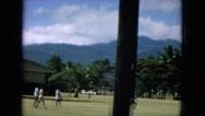 1964: boy running across field away from animal quarantine area in hawaii HAWAII Stock Footage