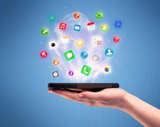Hand holding tablet phone with app icons Stock Photos