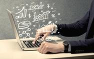 Business man drawing charts with laptop Stock Photos