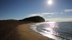 Jurassic coast Dorset at West Bay uk with sun shining people swimming Stock Footage