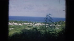 1964: weather on an island as the wind picks up a family hangs clothes to dry. Stock Footage