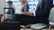 Businessman Working on Laptop while Waiting Boarding at the Airport Stock Footage
