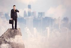 Winner urban businessman on top of stone Stock Photos