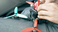 Assembling FPV drone preparing quadcopter flight Stock Footage
