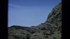 1964: a hilly area is seen with trees and greenery and water beside HAWAII Stock Footage