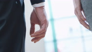 Close-up Shot of Man and Woman Joining Hands and Walking Forwards Stock Footage
