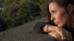Depressed lonely woman looking the sunset with a lost gaze Stock Footage