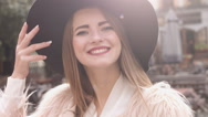 Portrait young girl smiling clothing fashion hat outdoors Stock Footage