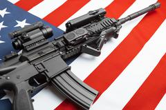 Part of national flag with machine gun over it series - United States of Amer Stock Photos