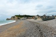 View of the beach and fishing boats in Etretat Stock Photos