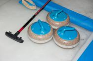 Curling stones on the ice Stock Photos