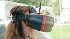 Woman watching flight of FPV drone using VR glasses Stock Footage
