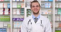 Pharmacist Man Greeting Looking Camera Happy Young Druggist Introducing Pharmacy Stock Footage