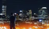 Businessman viewing night glowing city Stock Photos