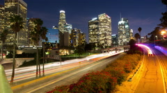 Time lapse of car lights, skyscrapers and palm trees in Los Angeles at twilight Stock Footage