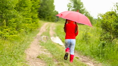 Girl with red umbrella Stock Footage