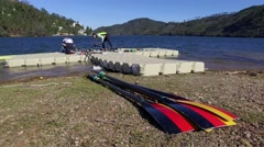 Women preparing to Sport rowing in Blue Lake - Zezere Portugal Stock Footage
